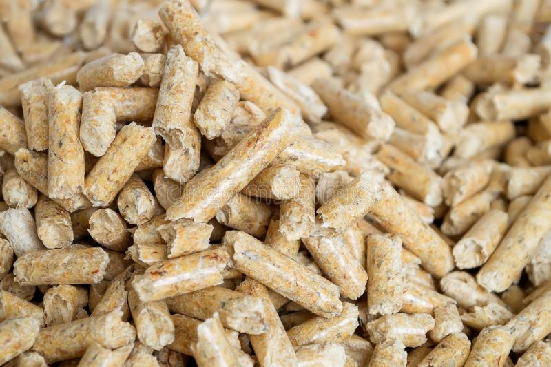Wooden pellets close up with selective foocus. Alternative biofuel from sawdust for burning in furnaces and stoves. Cat and hamste stock images