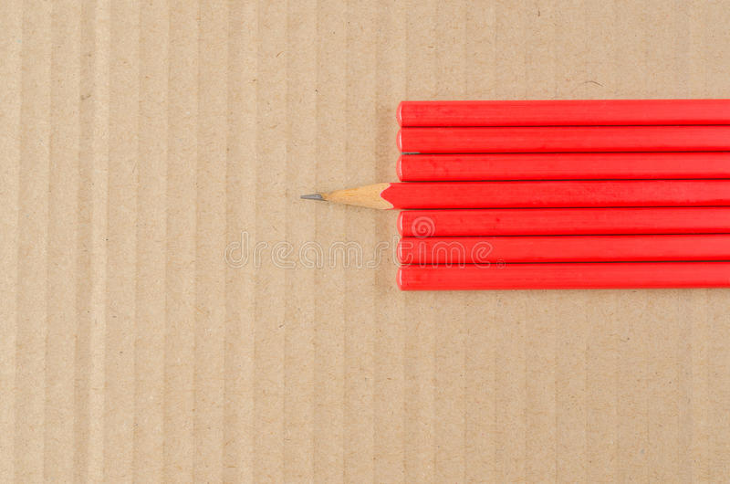 Wooden pencil. On cardboard, Idea for offices, schools, home royalty free stock photography