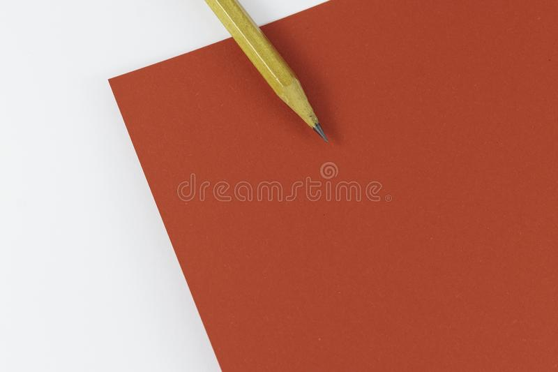 Wooden pencil on empty red letter on white background Valentine`s day. Or festive concept Letter or invitation inside Minimalist concept. Copy Space and royalty free stock photo