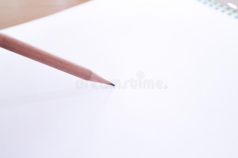 Wooden pencil and plain paper royalty free stock images