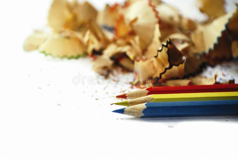 Wooden pencil shavings on white paper background royalty free stock images