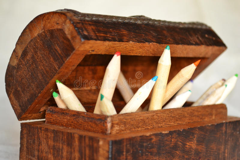 Wooden Pencils in a Chest. A set of wooden pencils in a wooden chest stock image