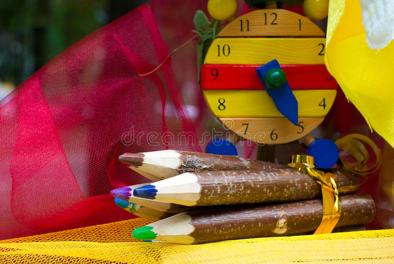 Wooden pencils and clock. Big wooden pencils and clock stock images