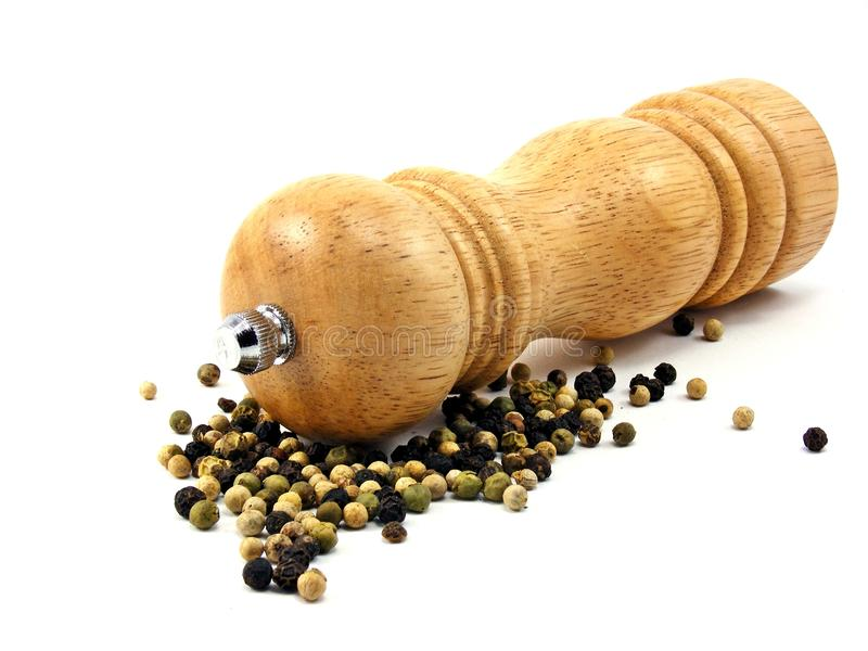 Download A Wooden Peppermill With Peppercorns Stock Photo - Image: 19022616
