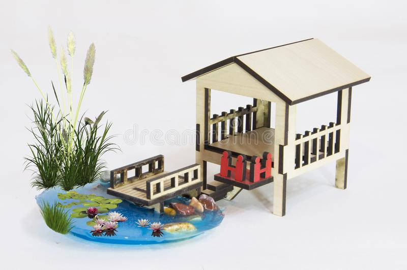 Wooden pergola model and small lake with wooden bridg royalty free stock photography
