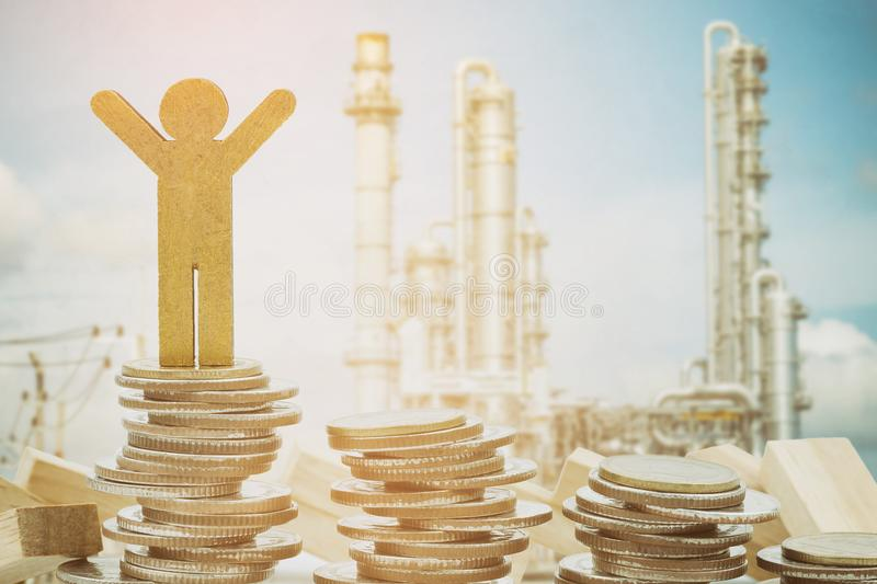 wooden person model and coins stacks royalty free stock photos