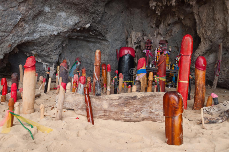 Wooden phalluses in Princess cave. Railay. Thailand stock photography