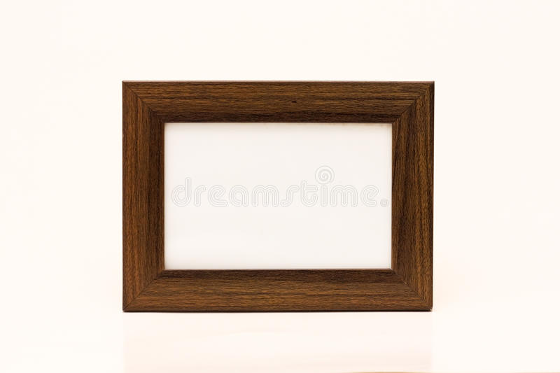 Wooden photo frame. A wooden photo frame isolated in a white background royalty free stock photography