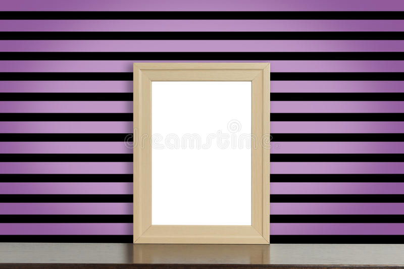 Wooden Picture frame on pink and black punk style stripe wall. Wooden Picture frame on pink and black gothic style stripe wall stock photos