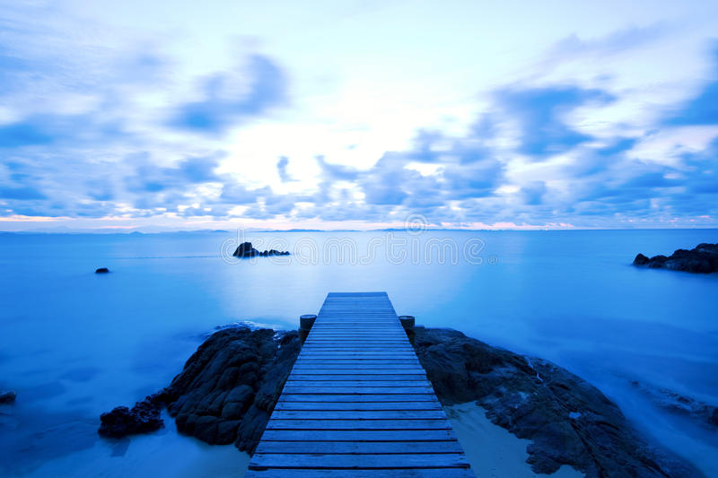 Wooden pier at the beach royalty free stock photography