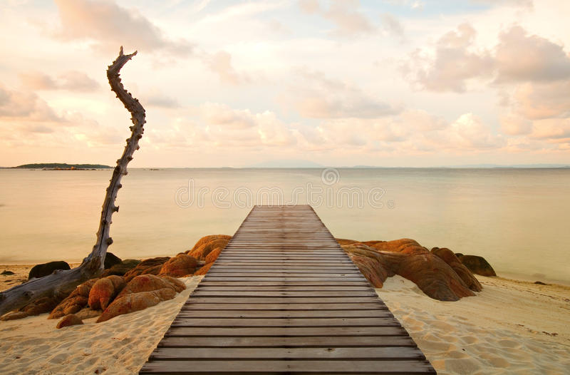 Wooden pier at the beach stock photos