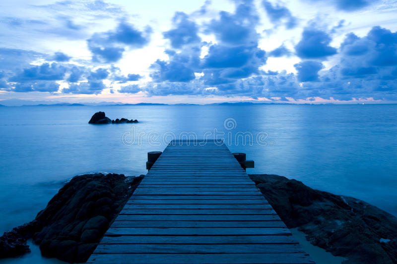 Wooden pier at the beach royalty free stock images