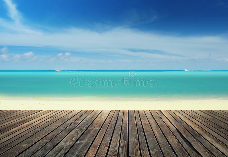 Wooden pier on the beach royalty free stock photo