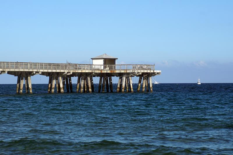 Wooden pier at the beach in Fort Lauderdale. Wooden pier at the beach on Pompano Beach, in Fort Lauderdale, Florida, USA, on Christmas Day stock photo