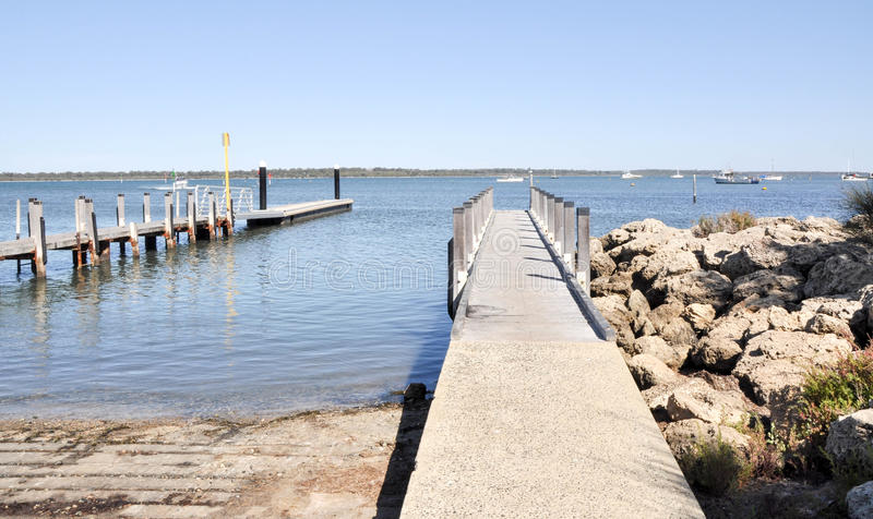 Wooden Pier and Boat Launch royalty free stock photos