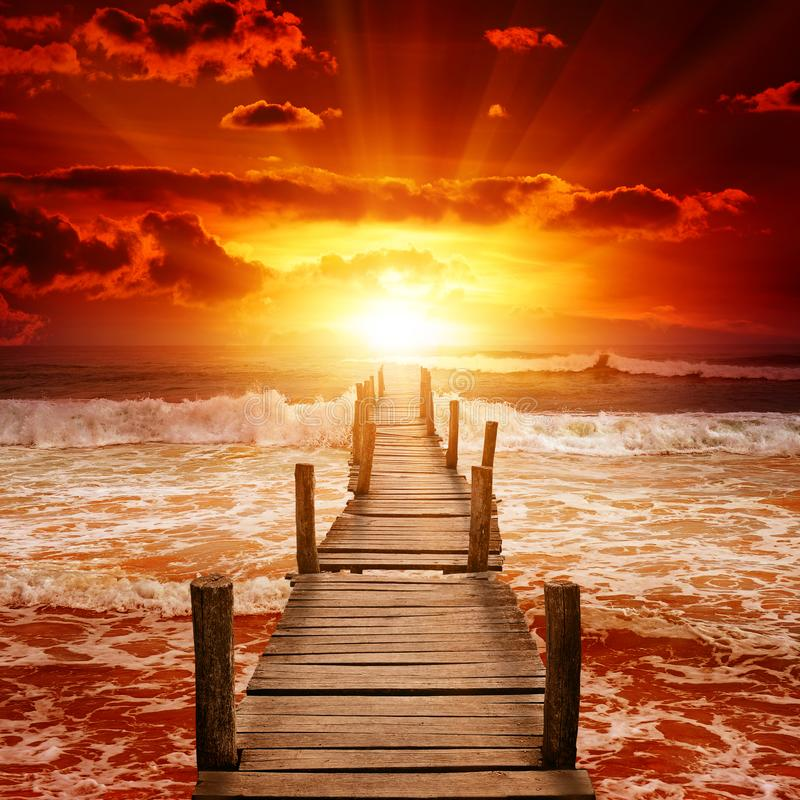 Wooden pier for boats in ocean. stock image