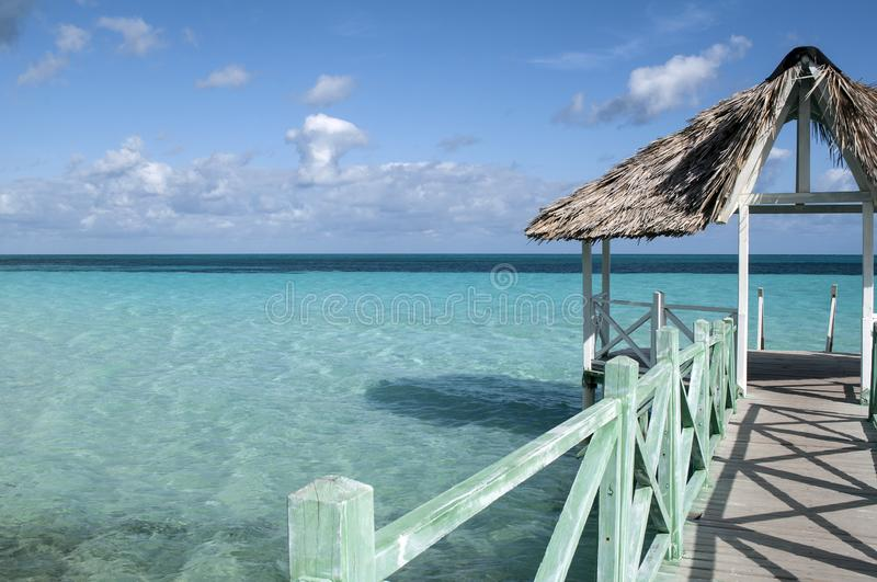 Wooden pier in the Caribbean. stock images