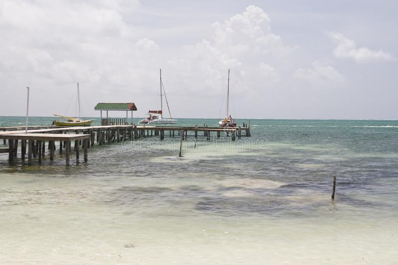 Wooden pier, Caye Caulker royalty free stock images