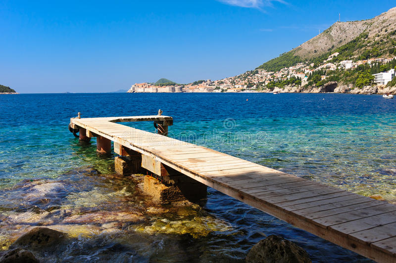 Wooden pier Dubrovnik. Wooden pier on the beach below St. Jacob's church and Belvedere hotel, across from Dubrovnik royalty free stock photo