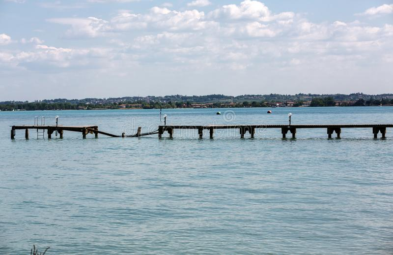 Wooden pier on Garda Lake in Sirmione. Italy stock photos