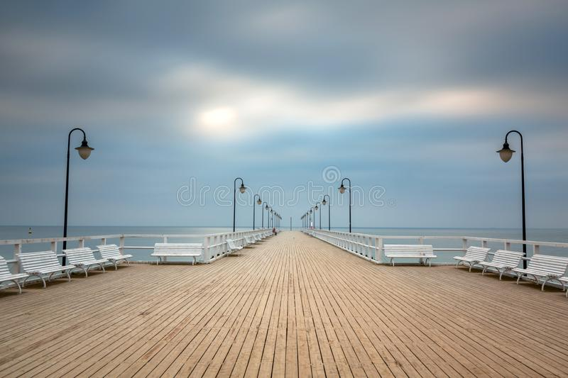 Wooden pier in Gdynia Orlowo at dawn, Poland royalty free stock images