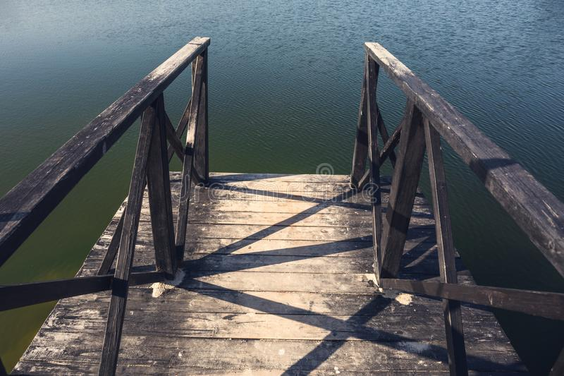 Wooden pier on lake summer travel background stock photo