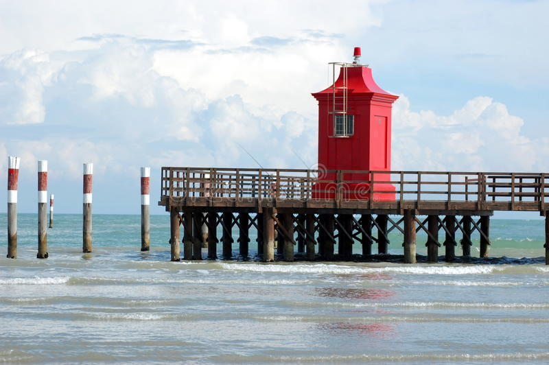 Wooden pier and lighthouse royalty free stock images