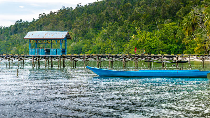 Wooden Pier of an local Village on Gam Island, West Papuan, Raja Ampat, Indonesia. Wooden Pier of an local Village on Gam Island, West Papuan, Raja Ampat stock photos