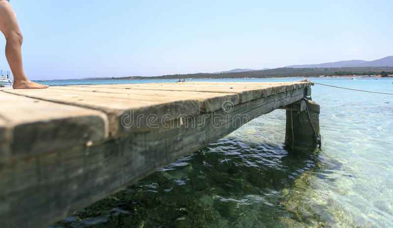 Wooden pier on the mediterranean sea royalty free stock images