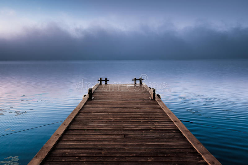 Download Wooden Pier Near Fog Cloud In Morning River Stock Photo - Image of footbridge, background: 26012622