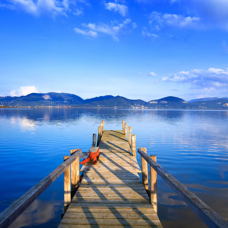 Free Wooden Pier Or Jetty On A Blue Lake Sunset And Sky Reflection On Royalty Free Stock Image - 38332686