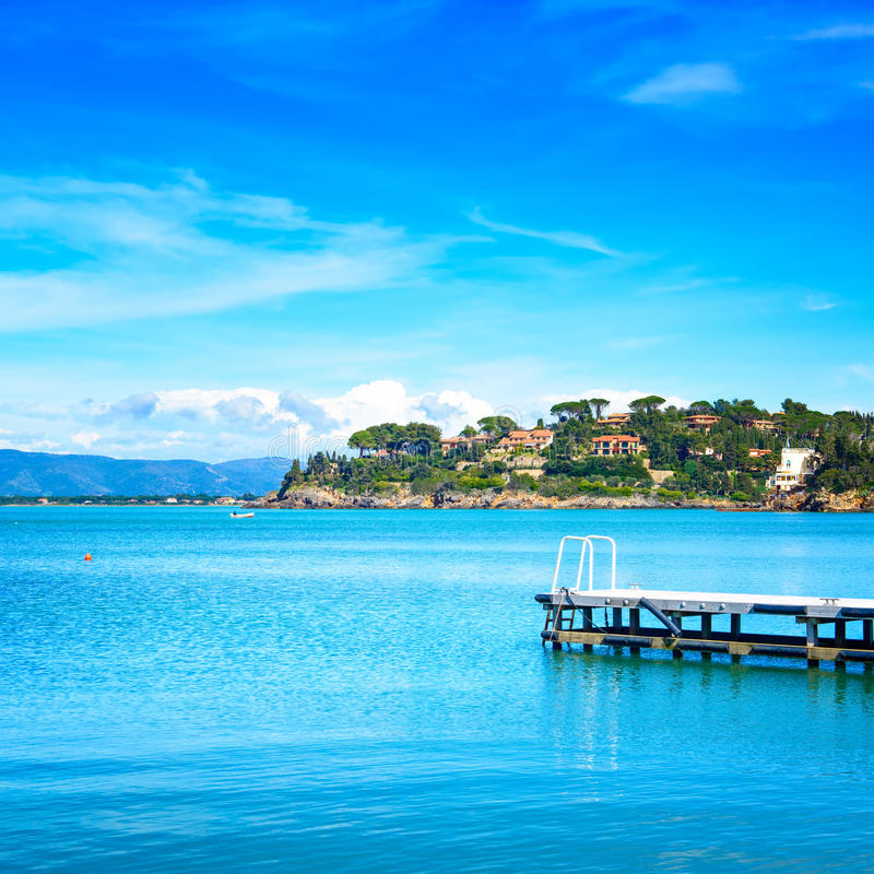 Free Wooden Pier Or Jetty On A Blue Sea. Beach In Argentario, Tuscany, Italy Royalty Free Stock Image - 34609196