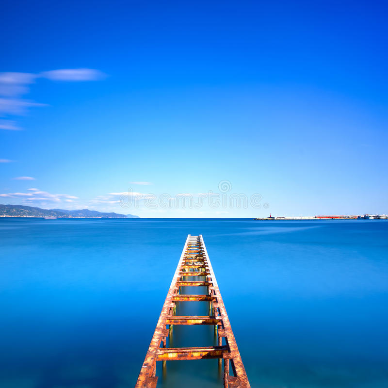 Free Wooden Pier Or Jetty Remains On A Blue Ocean Lake. Long Exposure Royalty Free Stock Images - 41667869