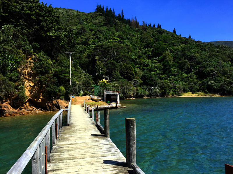 Wooden pier over water royalty free stock photo