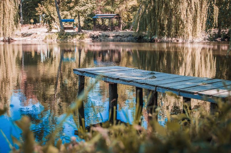 Wooden pier on lake. Wooden pier or platform on lake royalty free stock images
