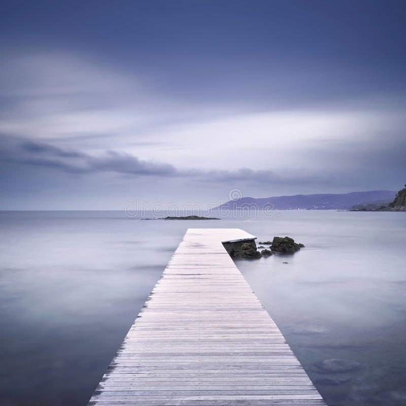 Free Wooden Pier, Rocks And Sea On Misty Sunset. Royalty Free Stock Images - 78955399