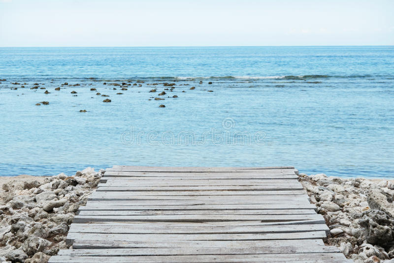 Wooden Pier, sea and Cloudy sky - Stock Images royalty free stock photo