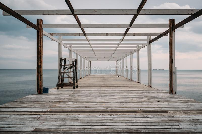 Wooden pier and sea, perspective, corridor view with no people royalty free stock photos