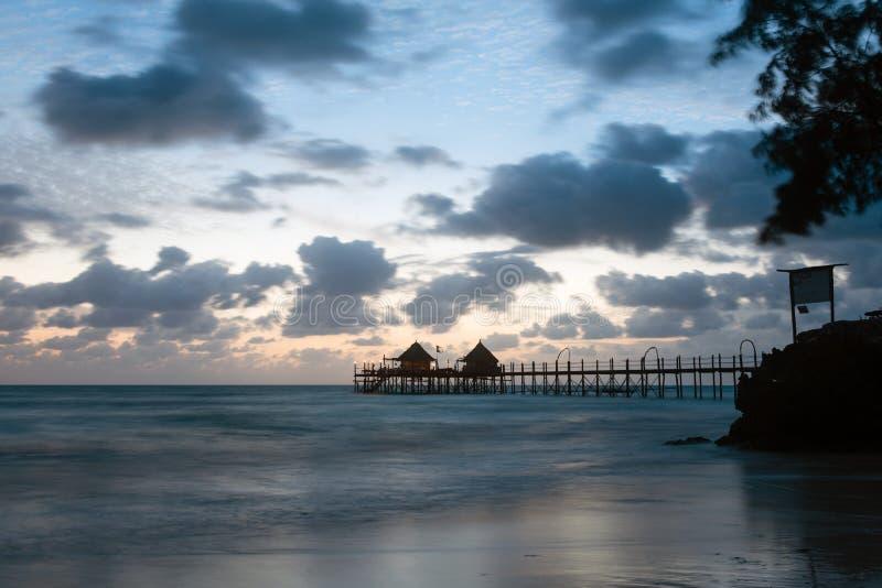 Wooden pier at sunrise, Zanzibar island royalty free stock image