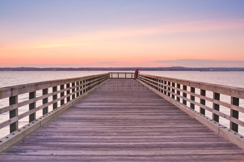 Wooden Pier at sunset. Perspective view of a wooden Pier at sunset in New Haven, Connecticut royalty free stock image