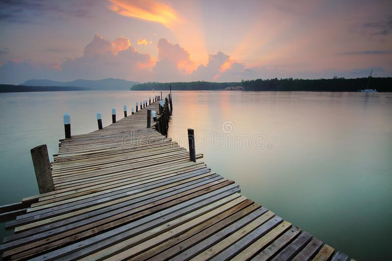 Wooden pier at sunset royalty free stock image