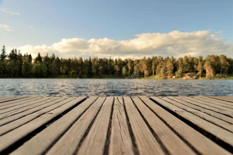 Wooden pier on waterfront, Sweden stock images