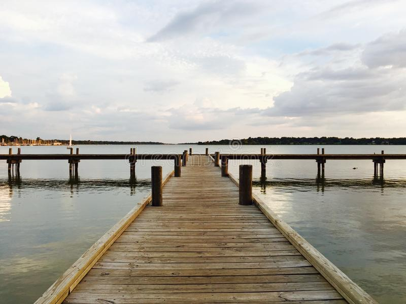 Wooden Pier, White Rock Lake, Dallas Texas. Wooden pier or dock looks out over White Rock Lake in Dallas, TX USA. Lake is part of White Rock Lake Park, a center royalty free stock photography