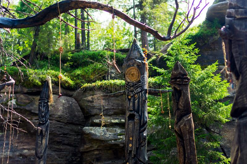 Idols among the rocks in the forest stock image