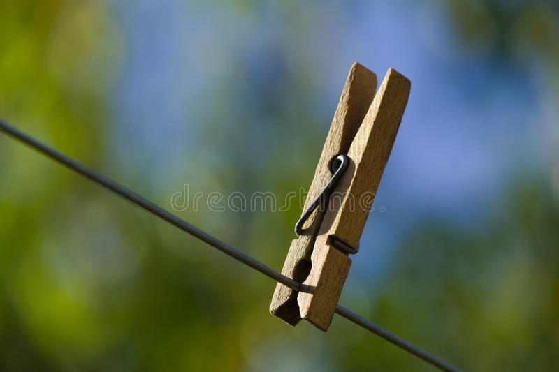 The wooden pinch on wire with blur background royalty free stock image