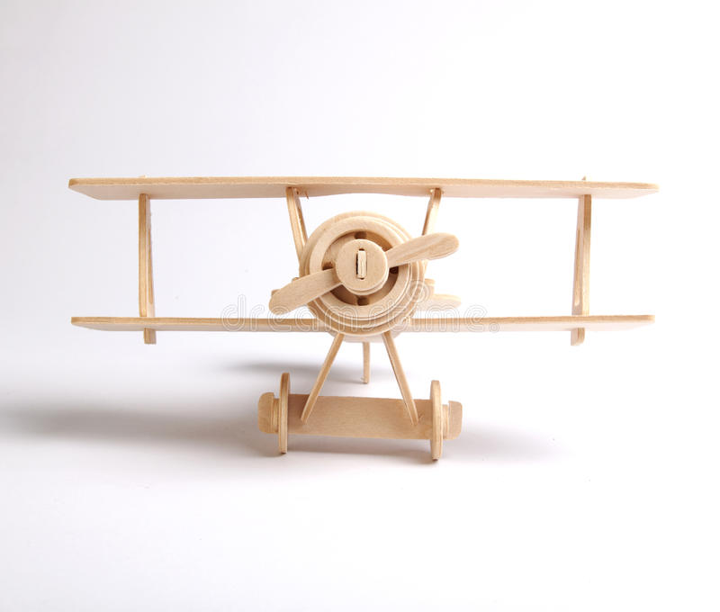 Wooden plane. Wooden airplane on a white background