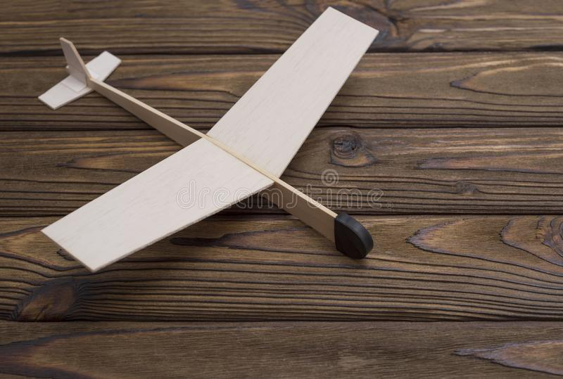 Wooden plane made a child on the background of wood. The old toy. stock photography