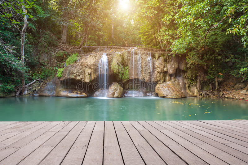 Wooden plank and background with Waterfall. In Erawan Park royalty free stock photography