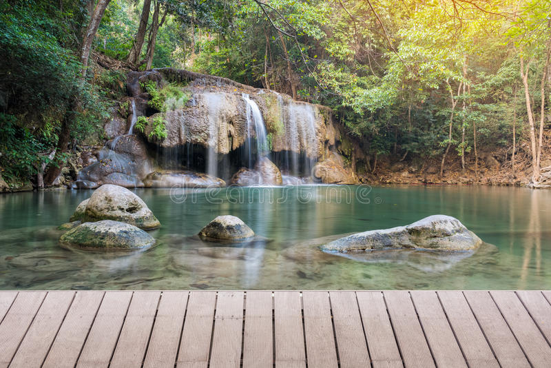 Wooden plank and background with Waterfall. In Erawan Park royalty free stock photos