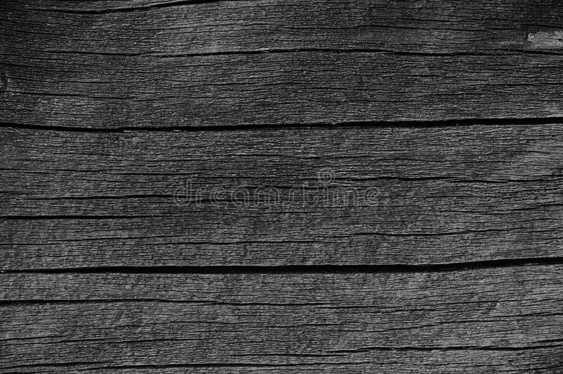 Wooden Plank Board Grey Black Wood Tar Paint Texture Detail, Large Old Aged Dark Gray Detailed Cracked Timber Rustic Macro Closeup. Pattern, Blank Empty stock photo
